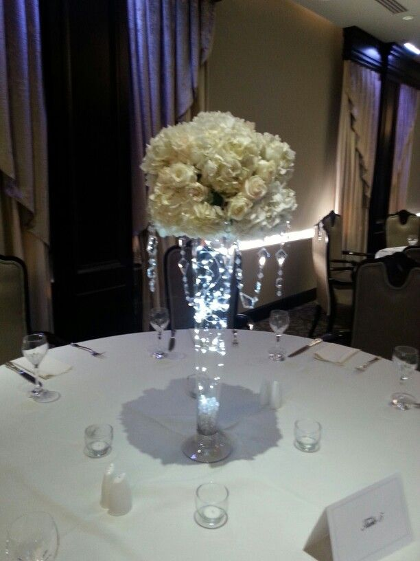 Ball Of Roses And Hydrangeas With Hanging Crystals And Lighted Trumpet Vase