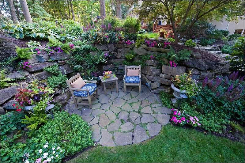 Grotto garden with deck in back ground galium odoratum at for Garden grotto designs