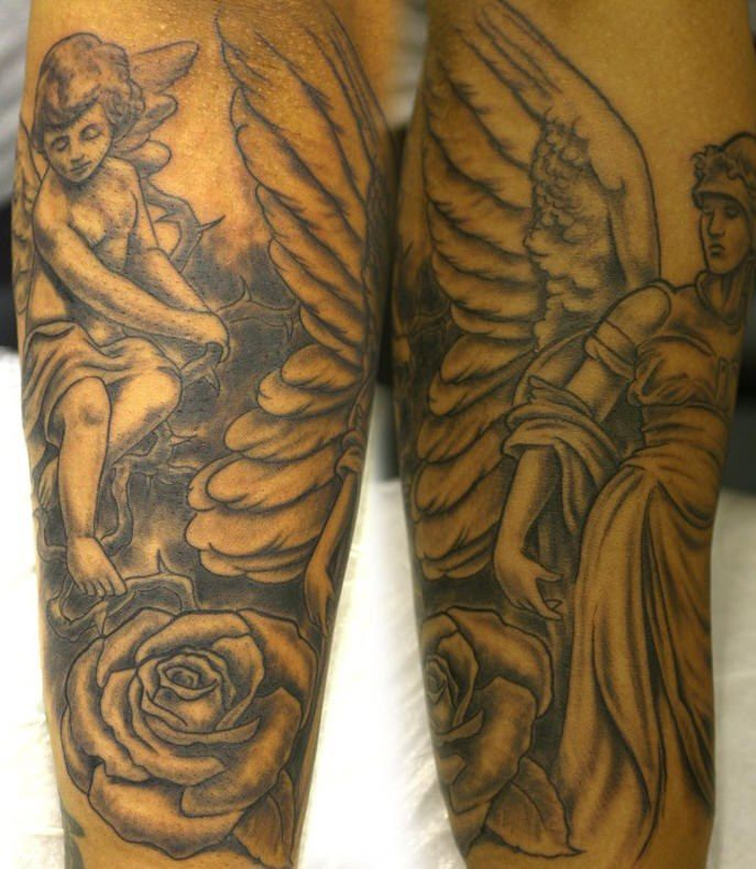 cherub angel and flower tattoo