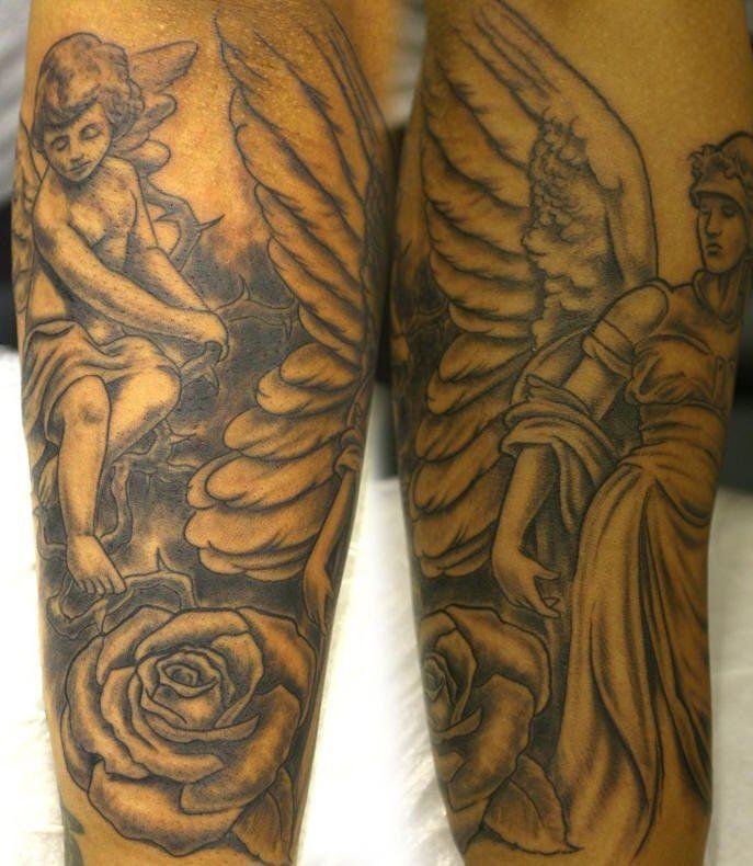 cherub angel and flower tattoo