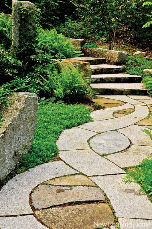 A stone walkway curves through the vayo meditation garden - Meditation garden design ideas ...