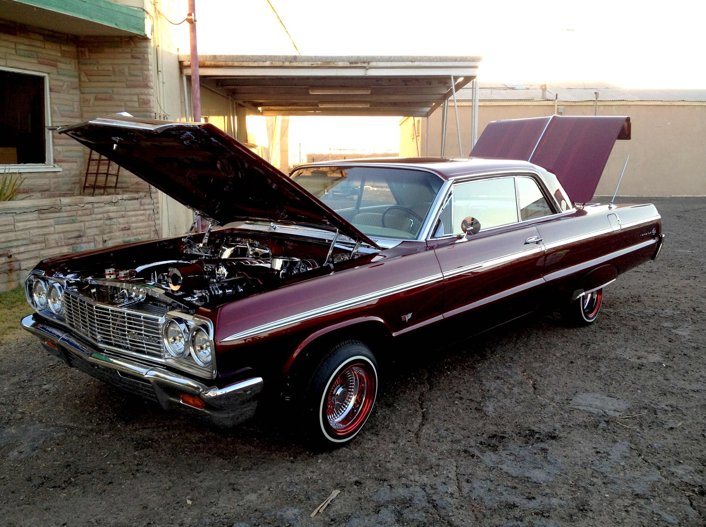 In 1964 this Chevy Impala SS with white rag top was my car She was