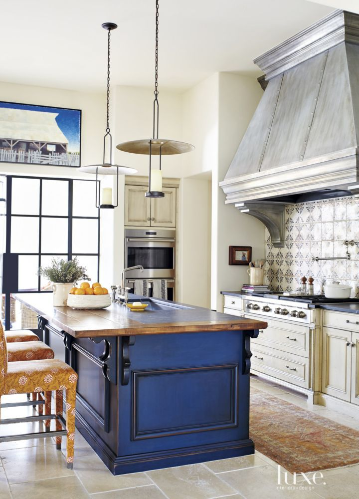 Mediterranean Cream Kitchen with Blue Island | LuxeSource | Luxe Magazine - The Luxury Home Redefined