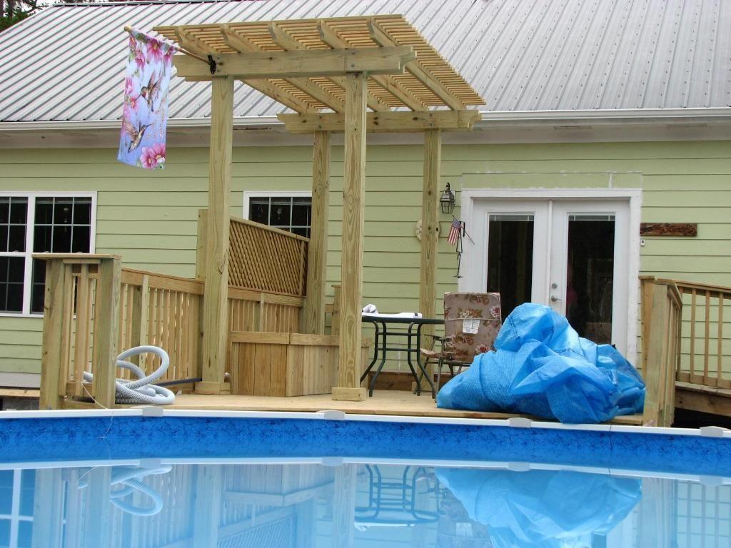 above ground pool decks | Enhance Pool Looks with Wooden Decks ...