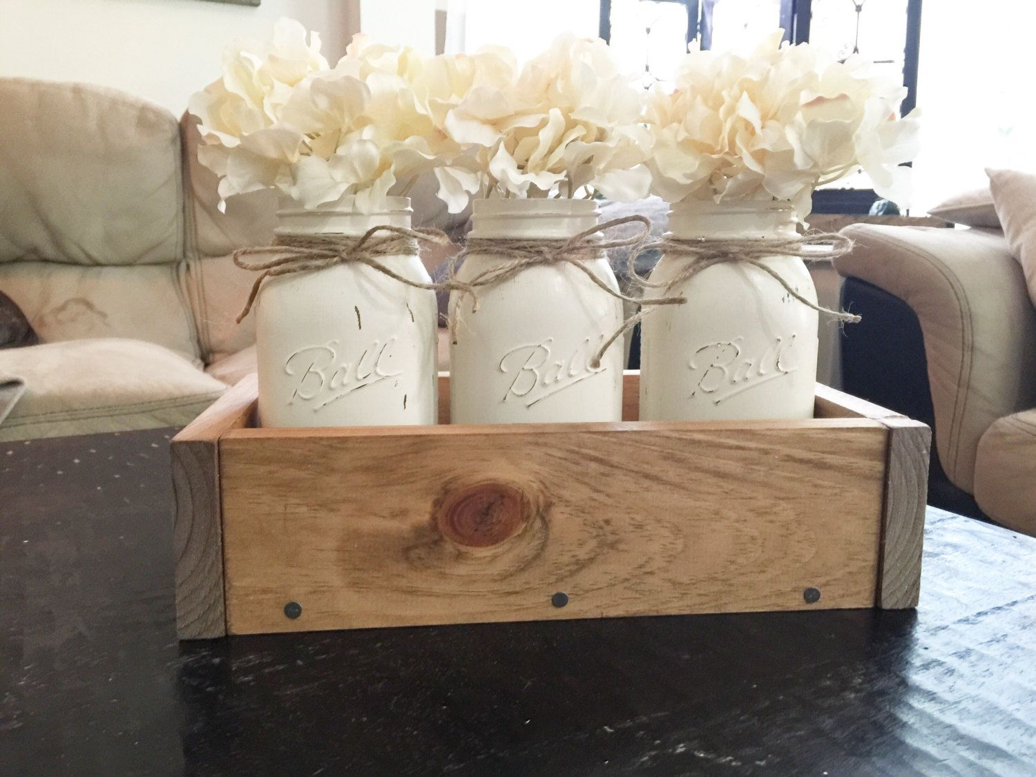 This Mason jar planter box is the perfect centerpiece for any table. It features three painted quart sized mason jars, each with a twine bow. We have fall colored flower arrangements at the moment but they won't last so order your thanksgiving centerpiece today! Check out this listing for our