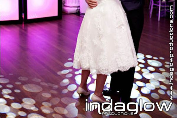 One of my favorite pics!!   intelligent lighting, uplighting, with LED DJ booth!  www.indaglowproductions.com