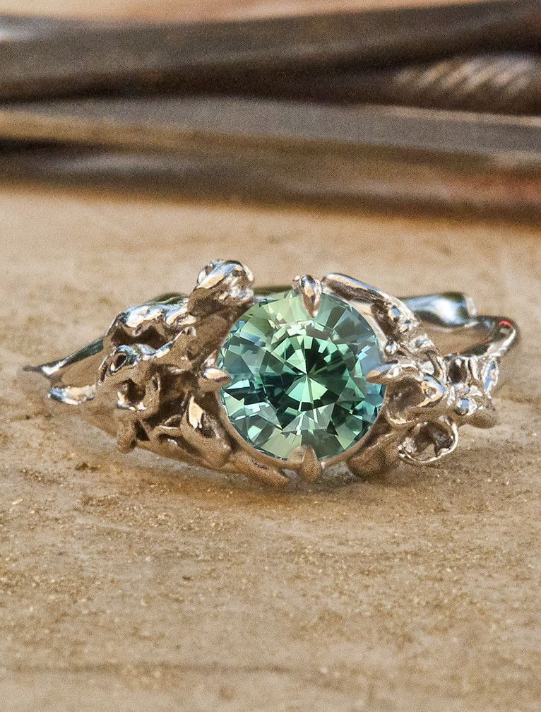 a mint green sapphire is surrounded by an organic nature inspired setting perfect for green sapphire engagement ringgold - Nature Inspired Wedding Rings