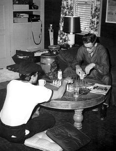 Perry Lopez and James Dean playing chess in his apartment, 1955.