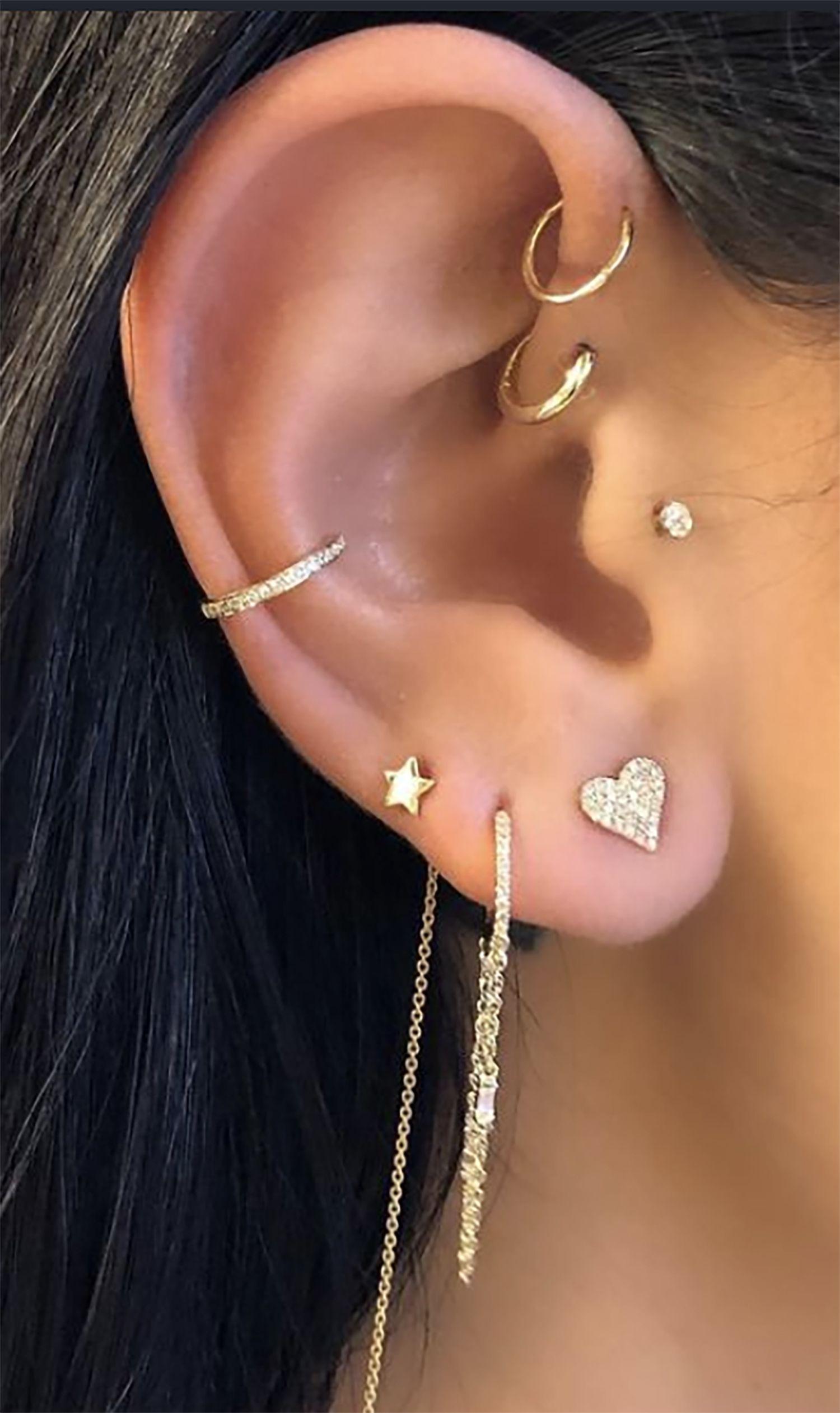 cute feminine multiple gold ear piercing jewelry ideas for women inspiration
