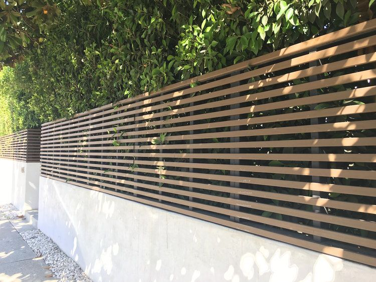 Modern Horizontal Wood Fence Gate Wall Terrain Following Detail Hollywood Ca Wood Fence Gates Wooden Fence Gate Fence Toppers