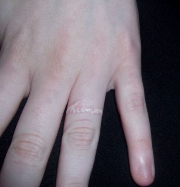 White ink tattoo on the ring finger. Might be a good couples tattoo ...