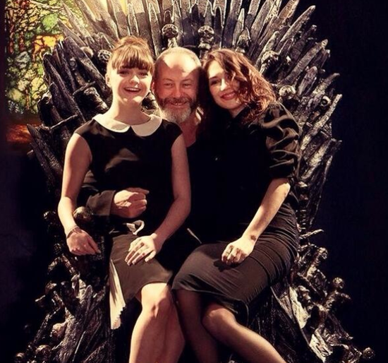 Sir Davos playing King (or Santa) with Arya Stark and the Red Woman