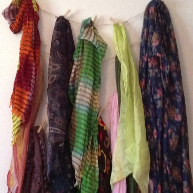 Twine net and clothes pins: cheap and easy way to display scarves.