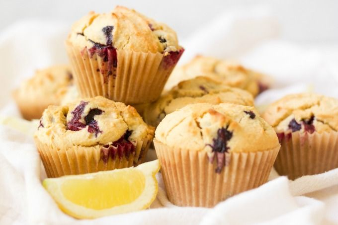 Grain free Blueberry Muffins are the perfect, protein-packed, on-the-go breakfast or afternoon snack. These delicious Paleo-friendly muffins are overflowing with blueberries and have a subtle buttery, lemon flavor. | Recipes to Nourish