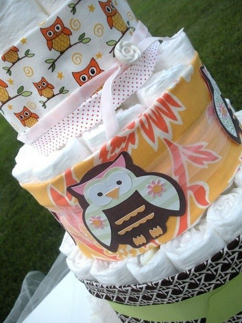 We are suckers for owl-themed anything! All this diaper cake needs are some @Skip Hop accesories!