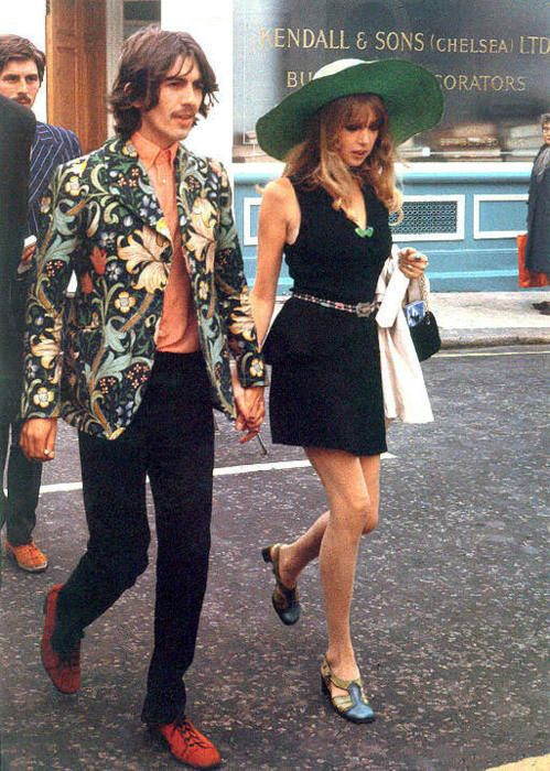 The 1970s couple du jour. George Harrison in pattern jacket hand in hand with lover girl Patti Boyd wearing oversized sunhat and mini dress.