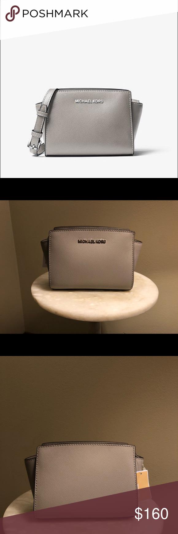 NWT MICHAEL KORS Selma Mini Gray Crossbody NWT Michael Kors Selma Mini  Crossbody. 100% Crossgrain Leather •Silver-Tone Hardware •8.25