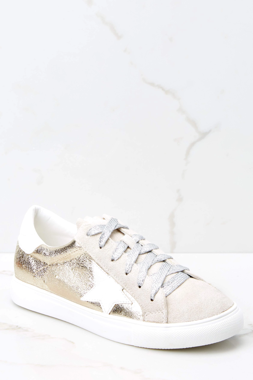 white and gold gym shoes