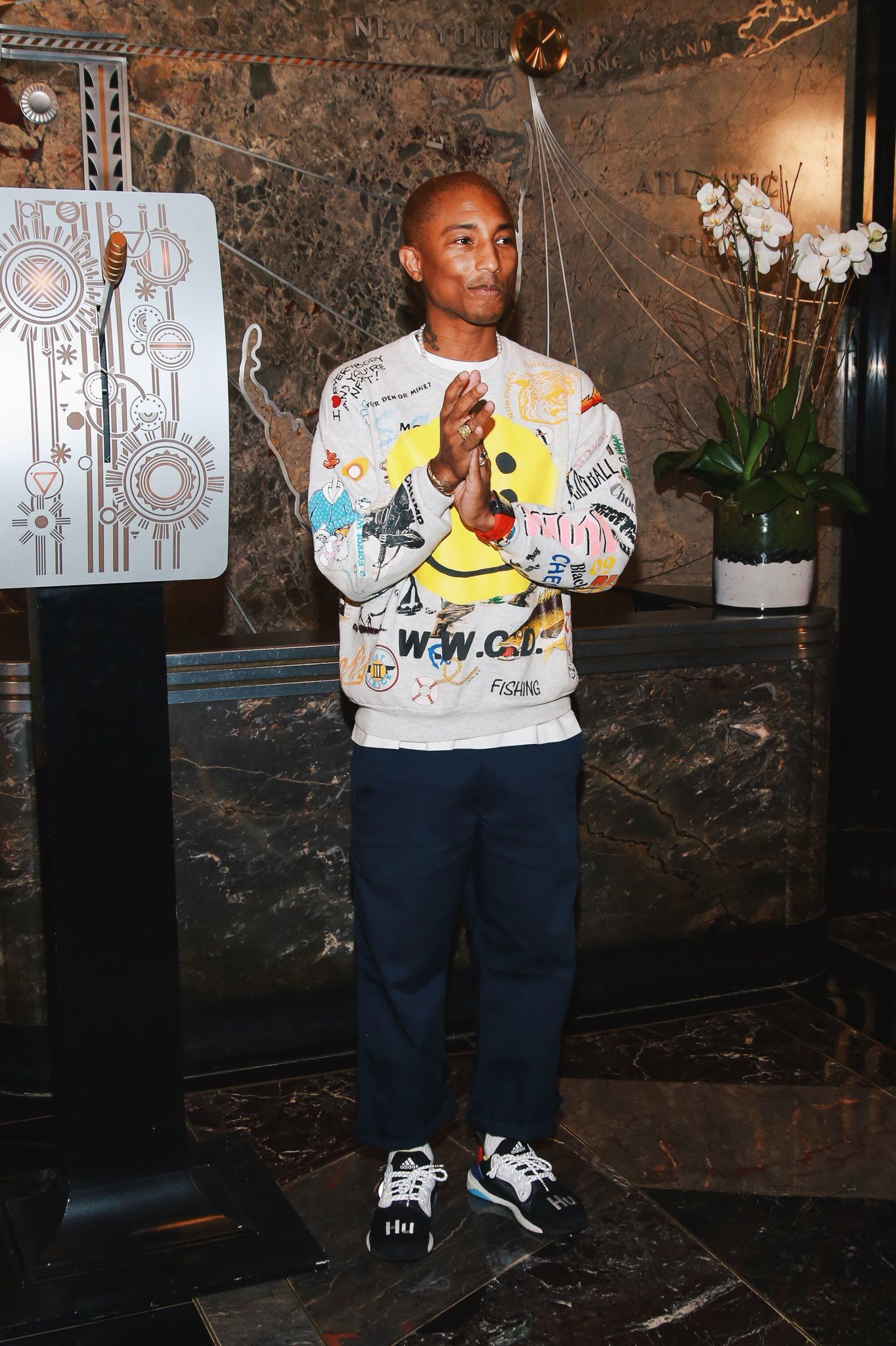 09a2450cd16ea Pharrell visits the Empire State Building wearing the Adidas Solar Hu  Glide…