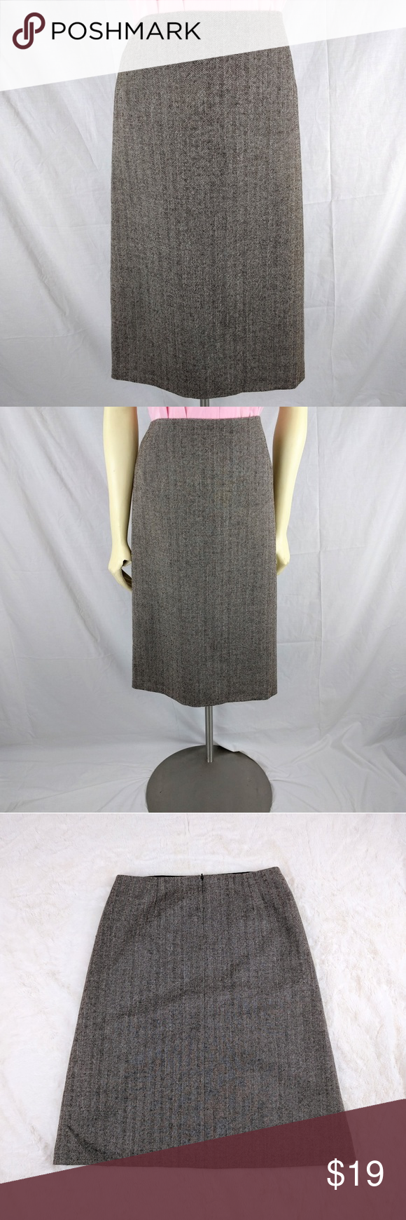 J. Crew factory A-line brown Wool Skirt J. Crew factory A-line skirt Color: brown 100% wool Back Zipper. Gently used. Very good condition. Lining: 100% acetate Dry clean  Waist: 32 in Hips: 40in Length: 26in J. Crew Factory Skirts Midi