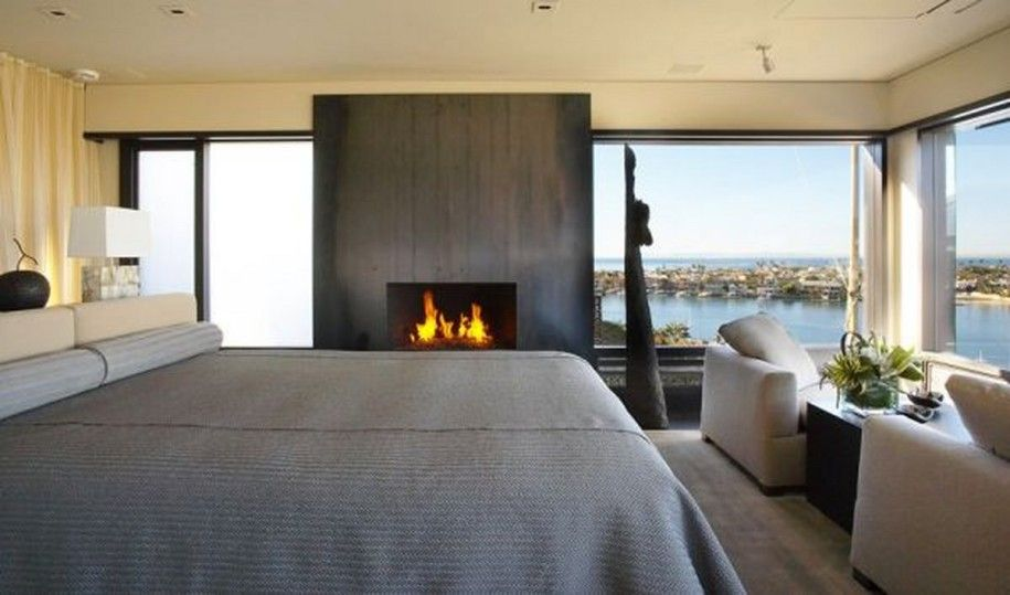 modern master bedroom with fireplace. Contemporary Californian Apartment Promises Gorgeous Harbor Views And Refined Interiors : Modern Master Bedroom With Big Fireplace