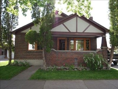 Craftsman Brick Bungalow Built In 1929 Deep Front Porch With Adirondack Chairs Natural