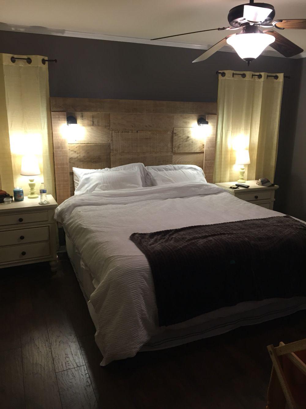 Barn wood headboard with wall lamps. Barnwood headboard
