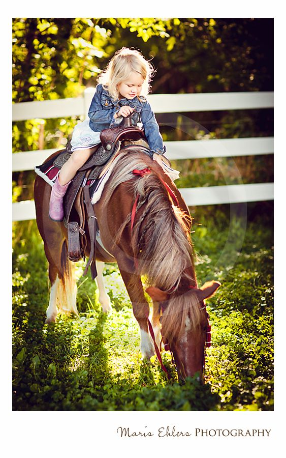 A little girl and her pony, Blueberry captured by Maris Ehlers Photography