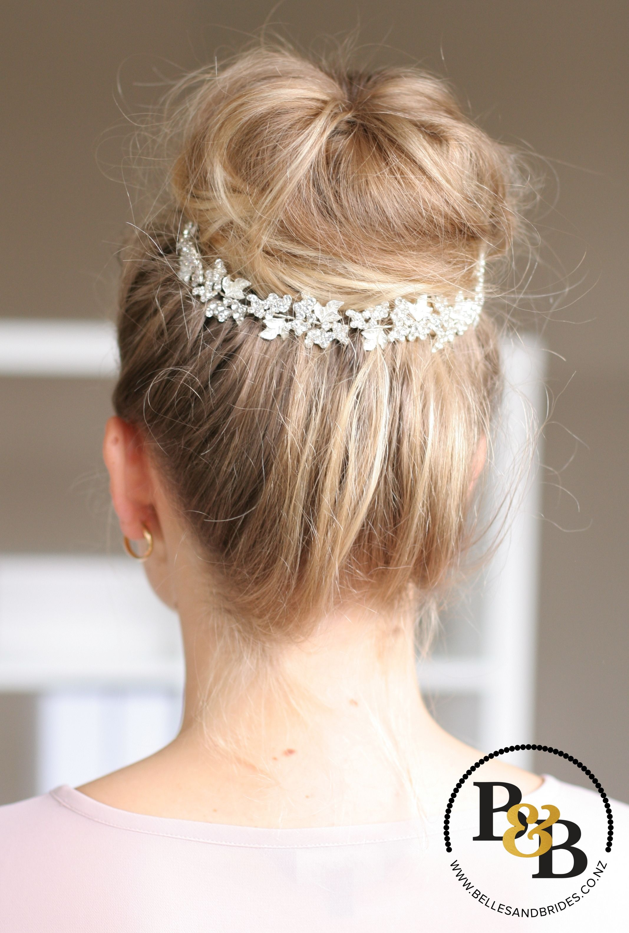 messy high bun with accessory / messy bridal bun / high bun