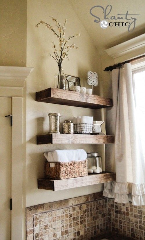 Floating shelves in a nice rustic y wood diy floating shelf tutorial half bath on main floor could use some pretty storage space