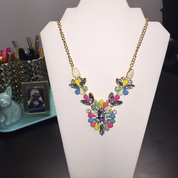"Multi Colored Statement Necklace 3 part multi colored statement necklace on a small chain link adjustable gold chain. Measures about 10.5"" in length and 4"" in width. All items are new from Side Dish mobile boutique close out. We are not interested in trading. We do offer discounts on bundled items.  Side Dish Jewelry Necklaces"