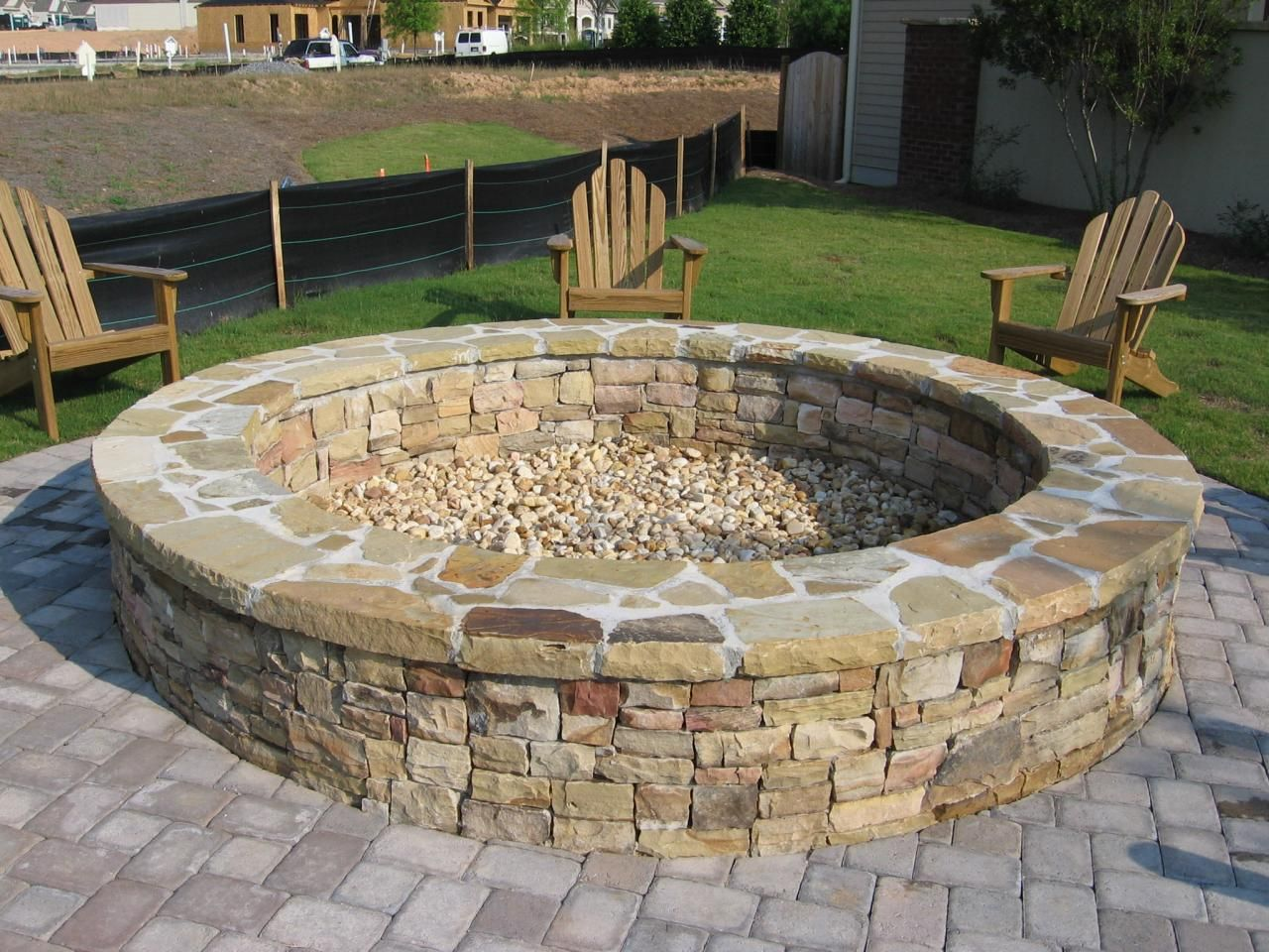 Stone fire pit designs patio traditional with artistic hardscape - Large Fire Pit Round Stone Fire Pit And Bench With Large Wooden Fire Pit Bench