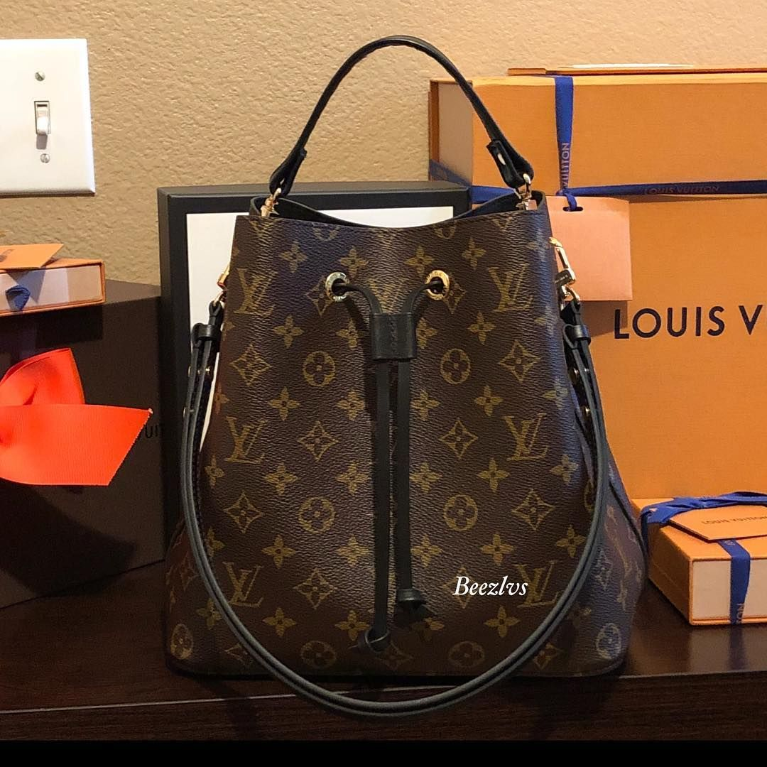 c2f0f6c8a736 Black leather top-handle on LV Neo Noe bucket bag