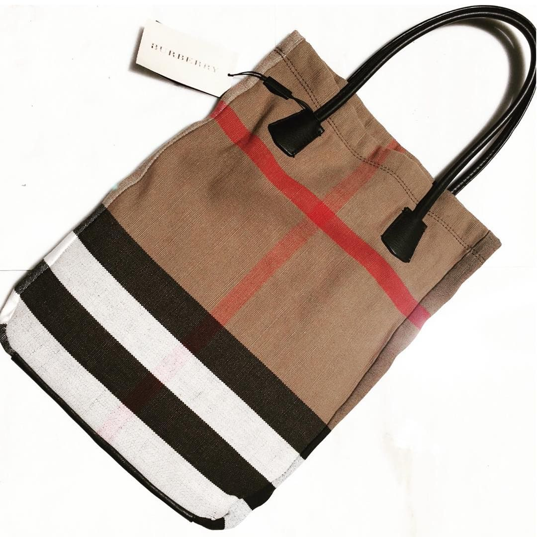 """The Yuppie Closet on eBay: """"Burberry's signature checks go vibrantly graphic on this canvas tote crafted with dual leather handles and an internal leather pouch for effortlessly organizing your fashionable essentials. #theyuppiecloset #onsitenow"""" 