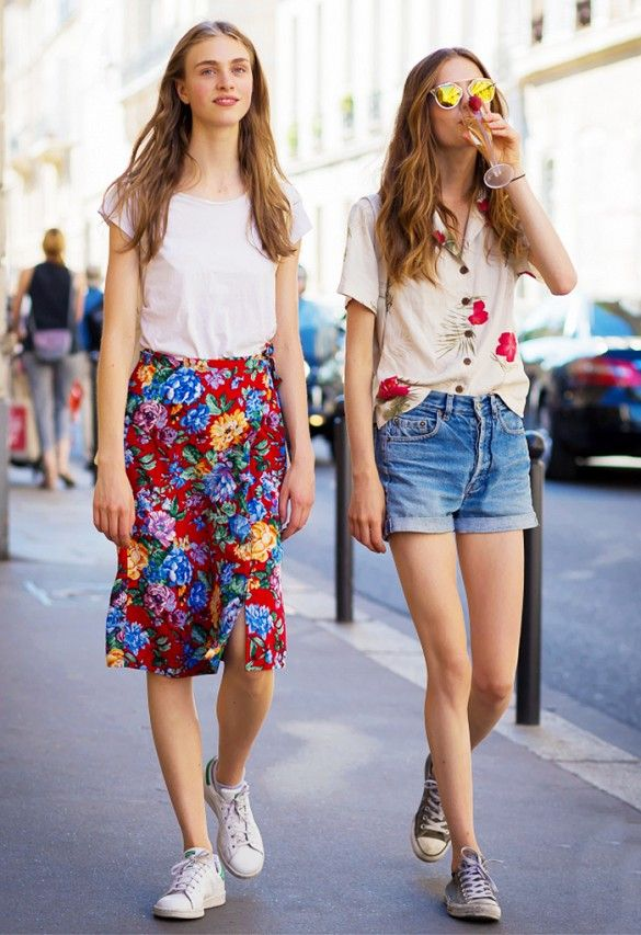 Left, model Hedvig Palm wears a white t-shirt, floral skirt, and Stan Smith sneakers. Right, a Hawaiian shirt is tucked into denim shorts, worn with sneakers and Dior sunglasses