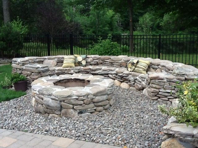Traditional natural stone fire pit natural stone fire for Backyard rock fire pit ideas