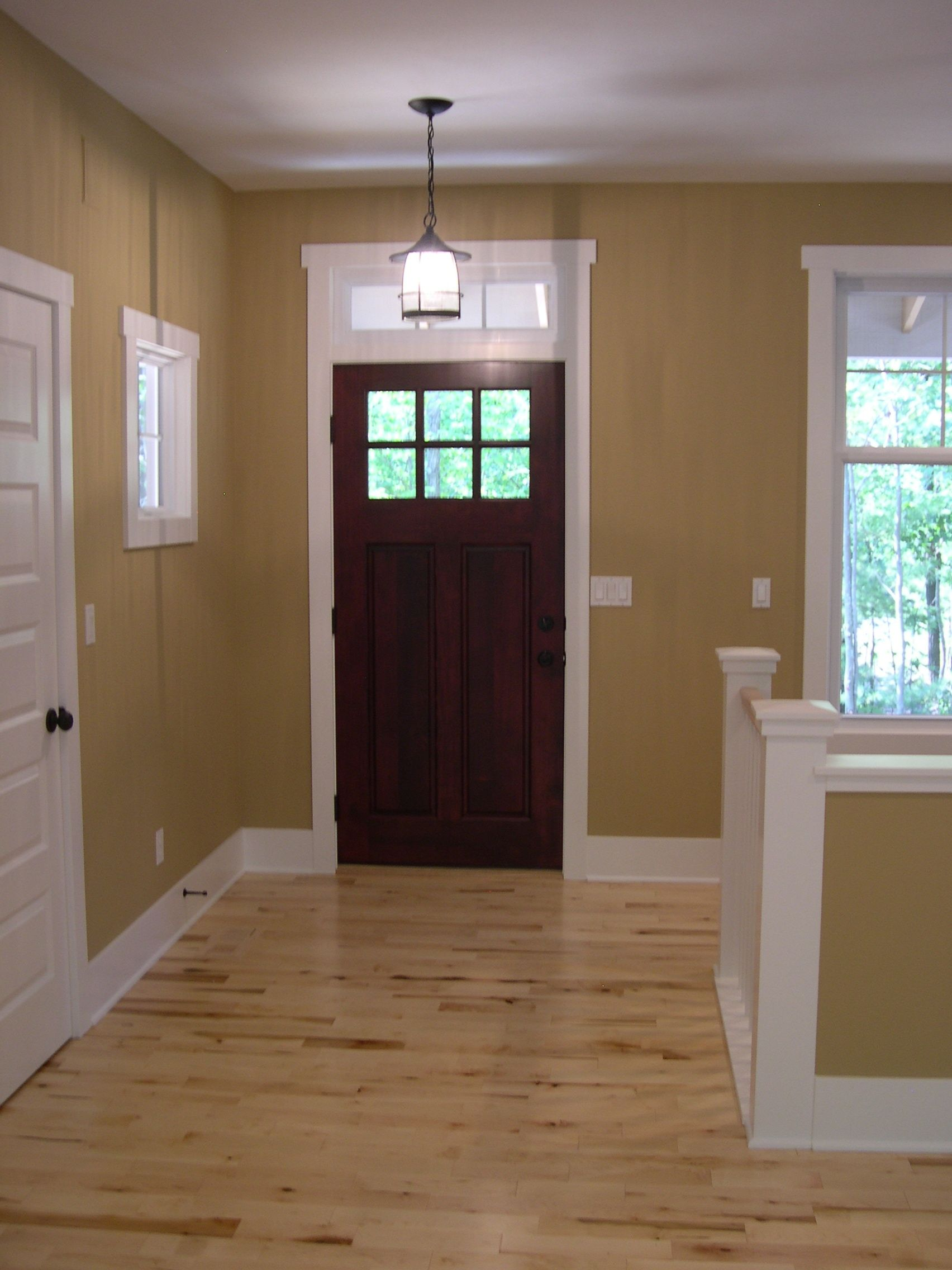 Front entry, interior stained Craftsmen style.