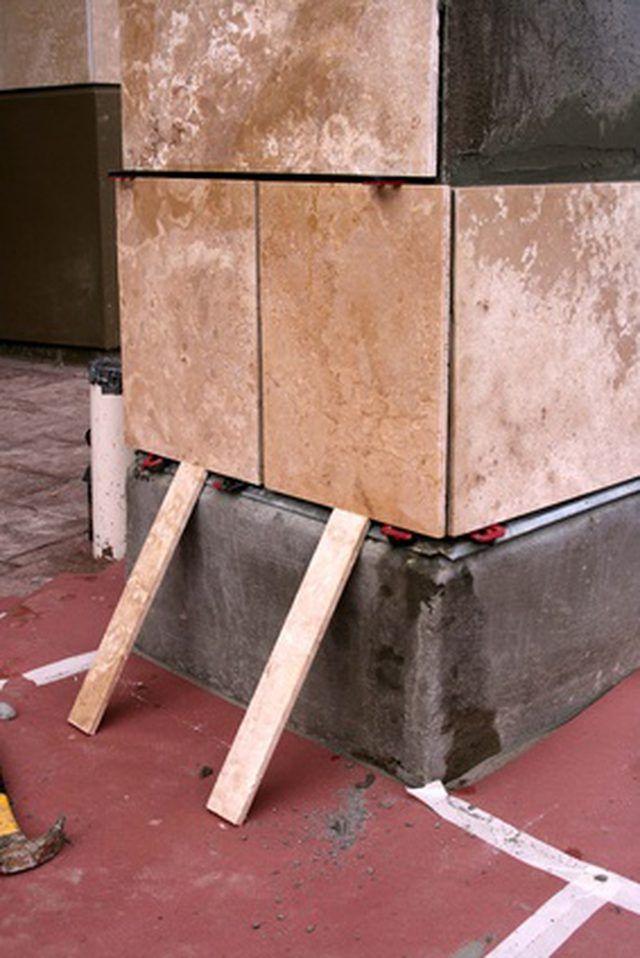 How To Remove Mortar From Slate Tiles Hunker Ceramic Tiles Slate Tile Granite Tile