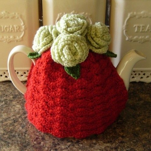Crochet tea cosy in red with pale green roses Handmade crochet tea cosy in red with pale green rose