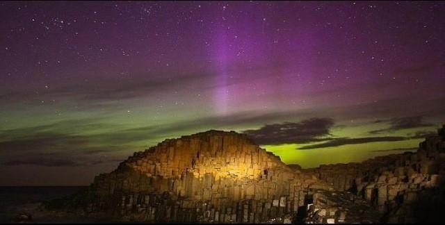 Beautiful photo of the Aurora Borealis at the Giant's Causeway, Northern Ireland.