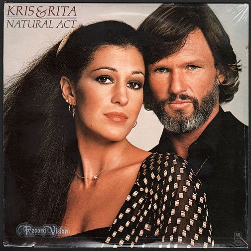 """""""Natural Act"""", the third and final duet album by Kris Kristofferson and Rita Coolidge, the couple would divorce the following year. It peaked at #24 on Billboard's Top Country Albums in the U.S. The album was released while Coolidge's career was at a peak; her recent albums """"Anytime...Anywhere and Love Me Again"""" had seen much commercial success. (Vinyl LP)"""