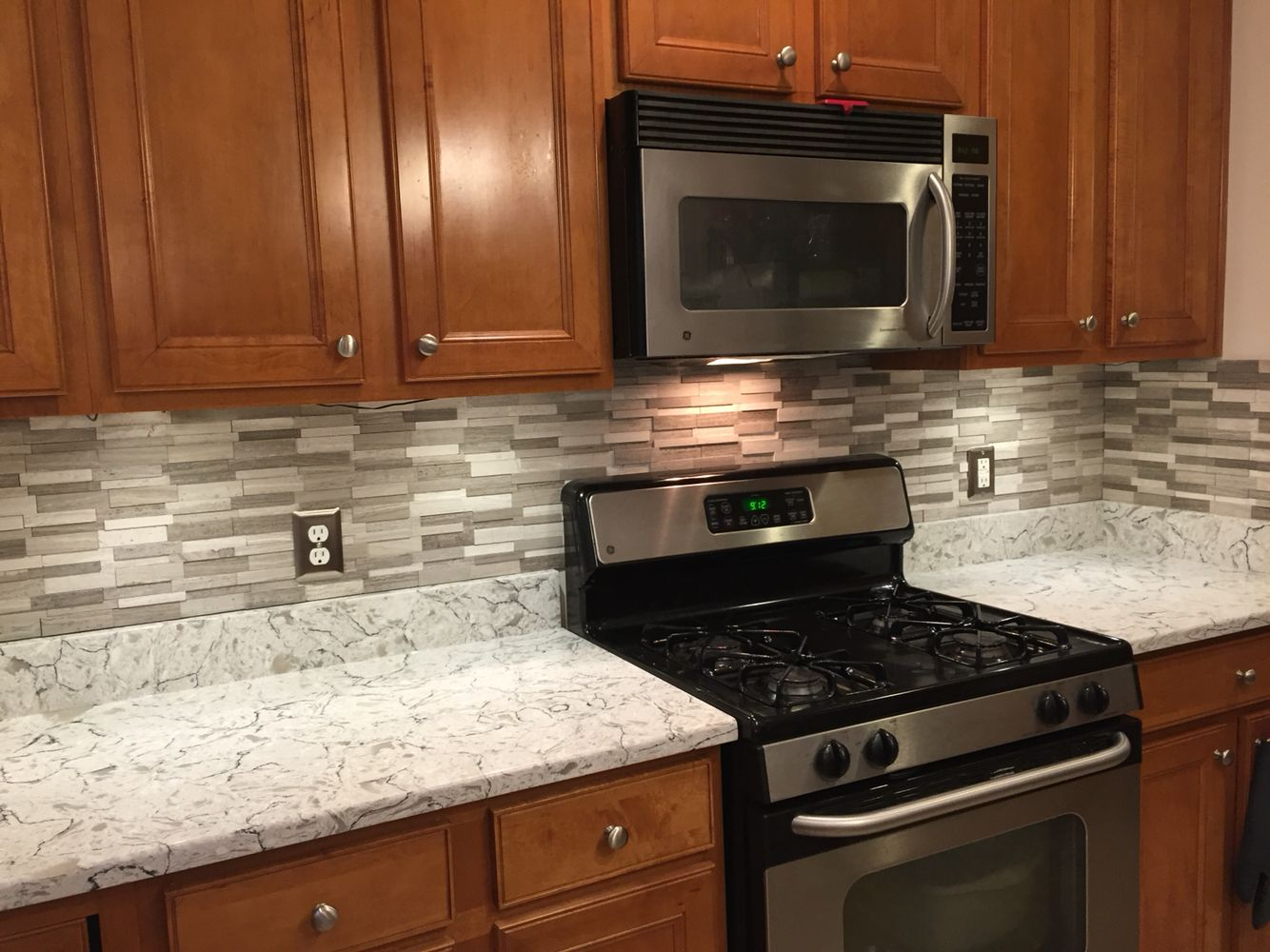 Done Installing Backsplash Over New Countertops Gray Subway Mosaic Wall Tiles On Spring Valley