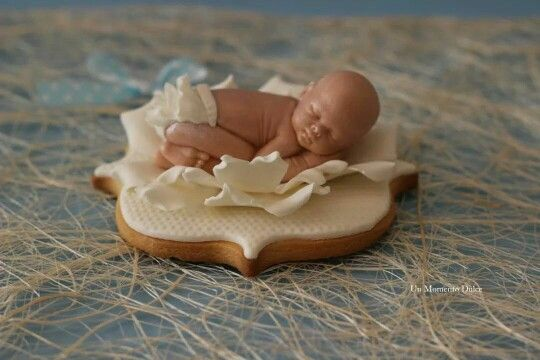 There Rico Exposito:  fondant sleeping baby on a cookie