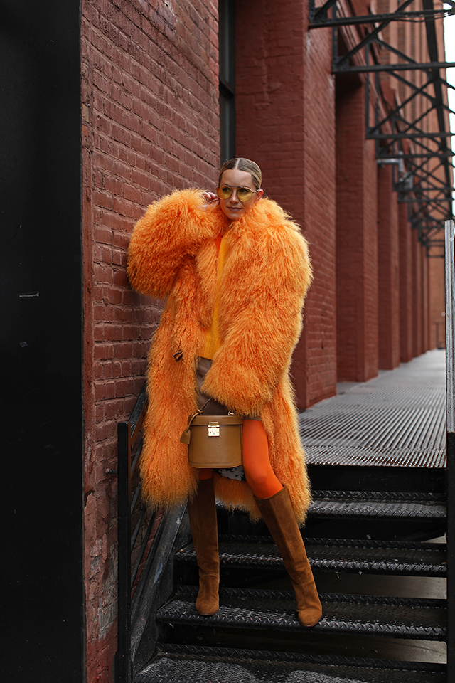 Fall is here and that means faux fur coats and bright tights // Blair Eadie wearing all of the monochromatic bright fall looks on Atlantic-Pacific // Click to see more!