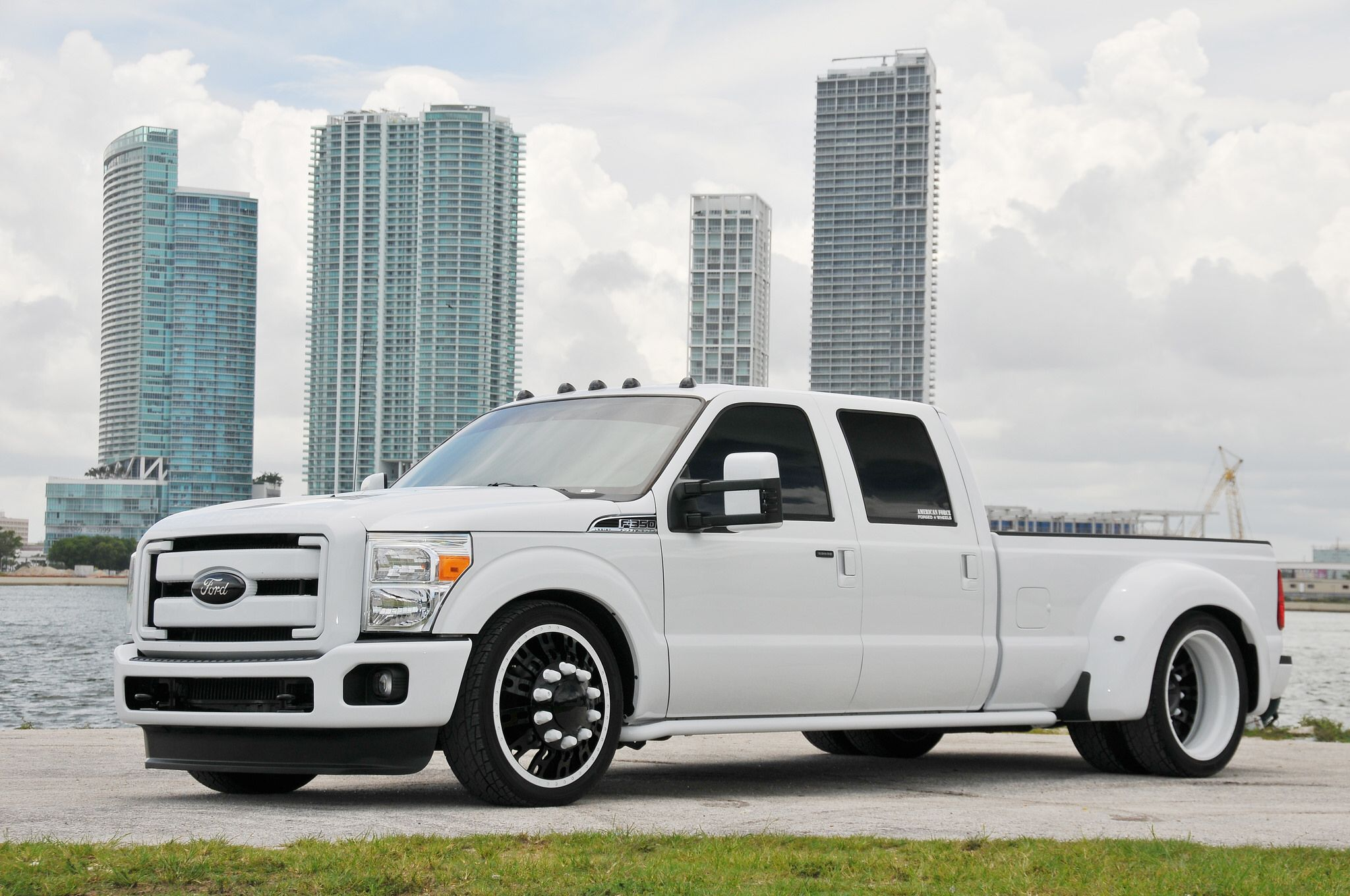 Lowered 8 lug customs ford dually on 24 fusion american force wheels