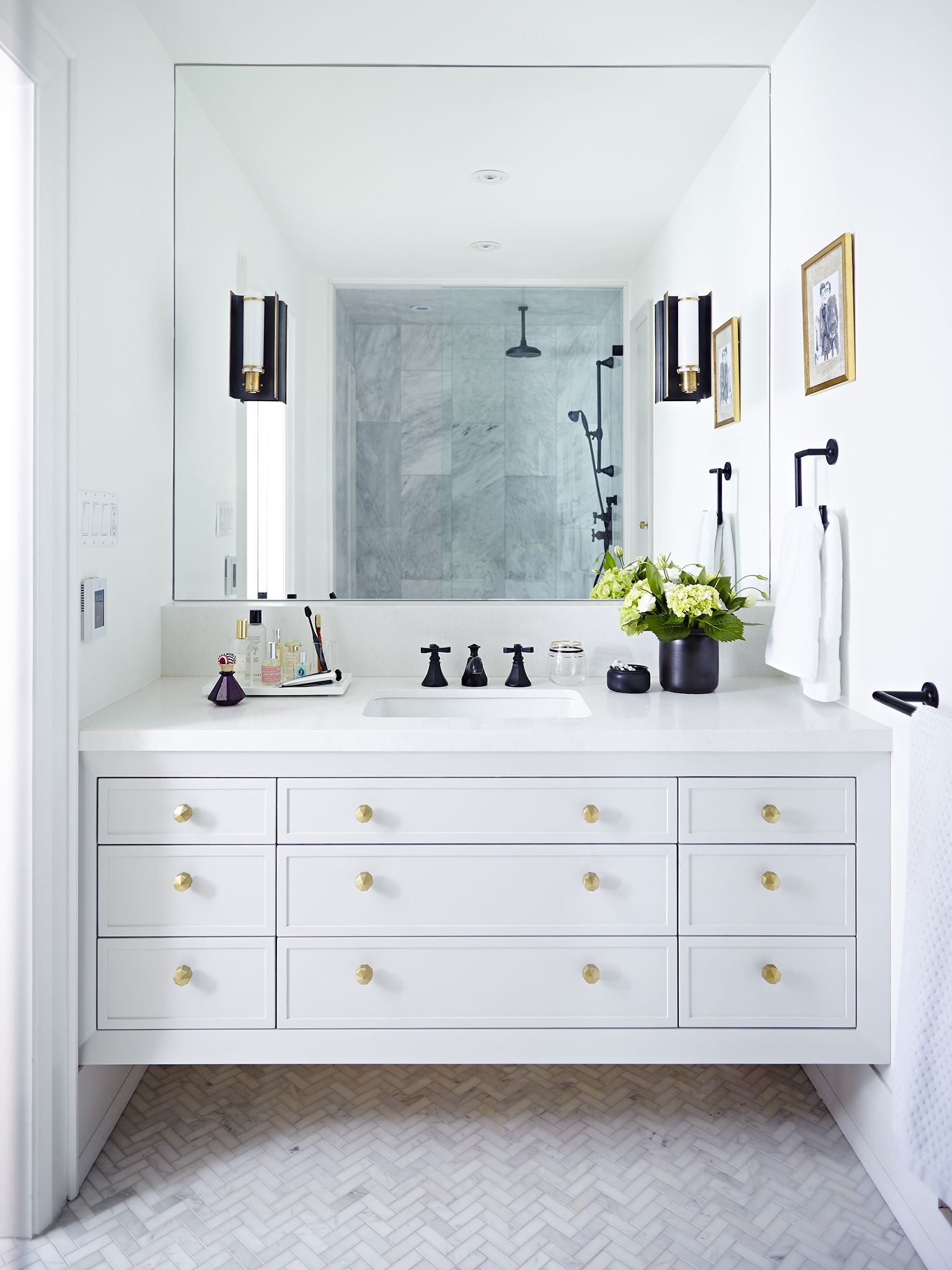 Beautiful all white bathroom design with chevron floor detailing