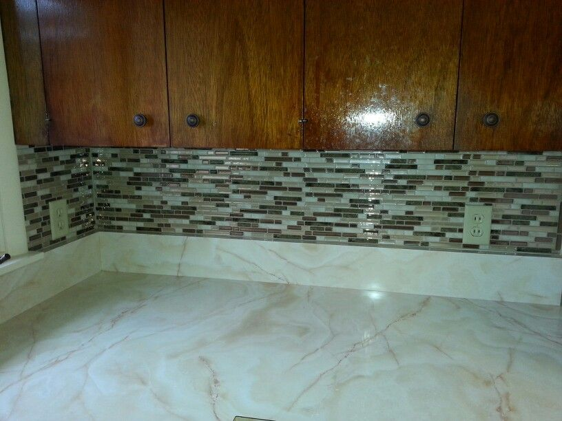 Love these smart tiles! I just installed this adhesive backsplash in the kichen of our rental