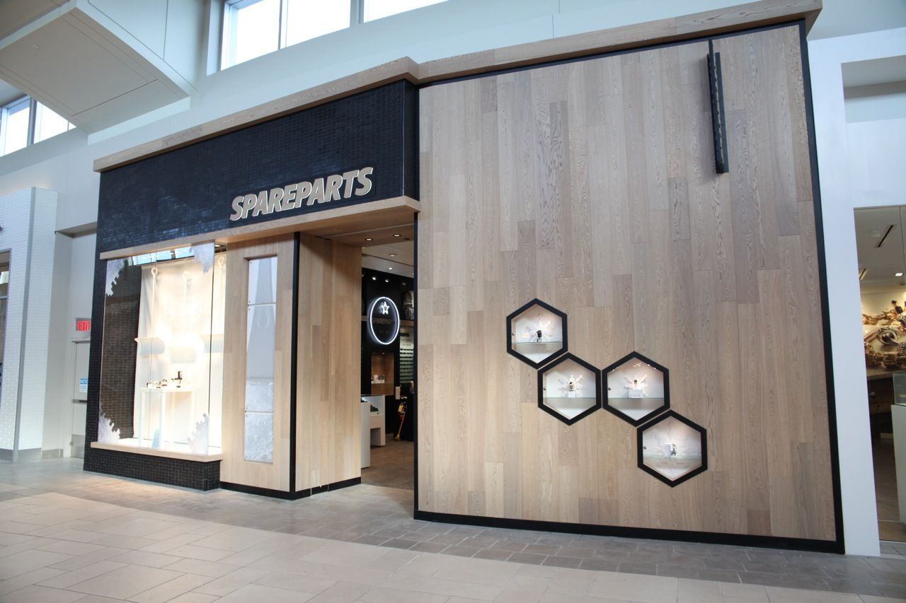 spareparts storefront at market mall by - Storefront Design Ideas
