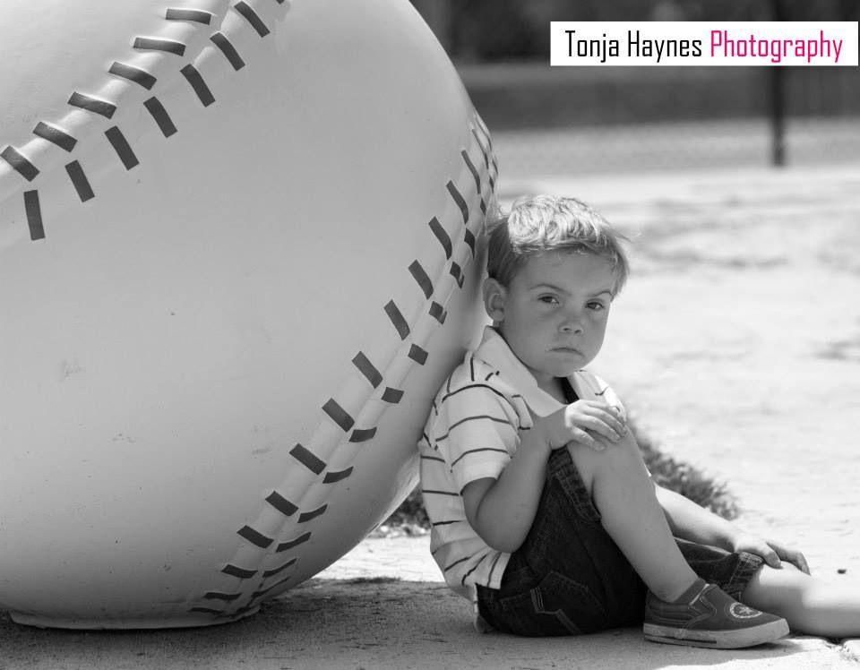 Little boy + giant baseball = Totally adorable photo! Taken by Tonja Haynes Photography