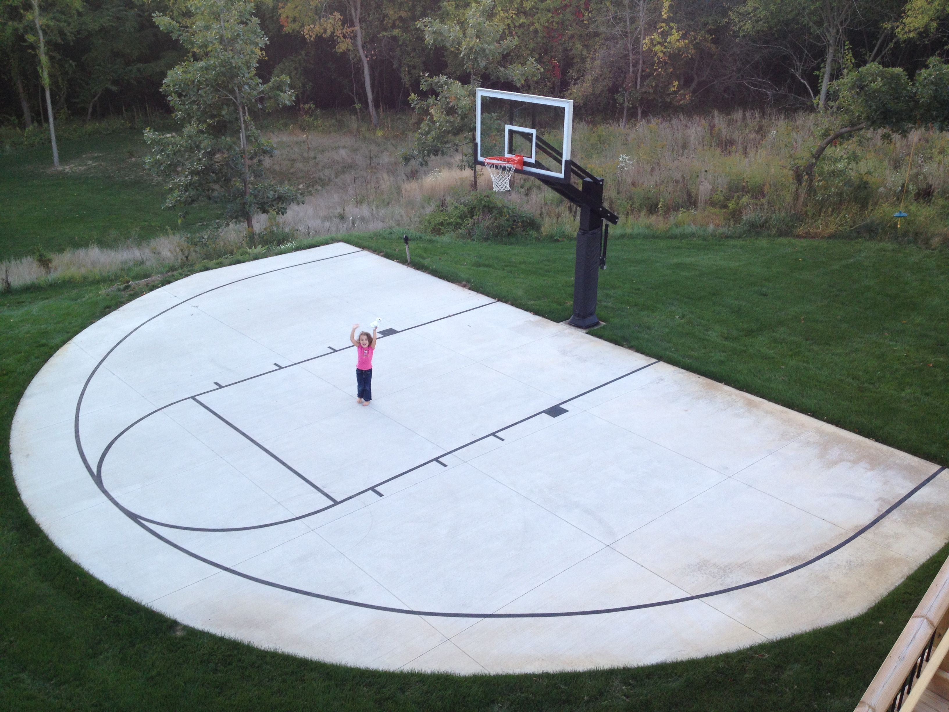 A Backyard Half Court With Striping Is Can Be An Inspiring Early